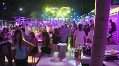 Hundreds of people party at a giant nightclub. - stock footage