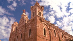 A time lapse as clouds drift over a Catholic Church. Stock Footage