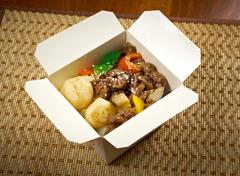 Take-out food - beef slice  and potato. Stock Photos