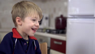 Stock Video Footage of Little boy smiling at lunch