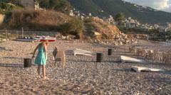 A blonde woman walks along the beach near Beirut, Lebanon. - stock footage