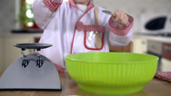 Stock Video Footage of Emptying small bowl of ingredients to bigger bowl