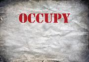 Stock Photo of Red Occupy letters on a grunge paper background