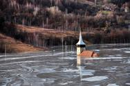 Stock Photo of abandoned church in a mud lake. natural mining disaster with water pollution