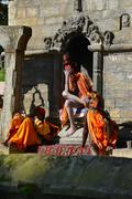 holy sadhu men with dreadlocks and traditional painted face in pashupatinath, - stock photo