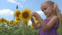 Smelling Girl, Child Playing Crop Sunflower Field, Children, Countryside, Farmer - stock footage