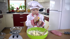 Stock Video Footage of Little cook with little scraper making dough for cookies