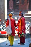 sadhu men seeking alms in durbar square. kathmandu, nepal - stock photo