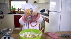 Cook looking why lemon peel doesn't scrape well Stock Footage