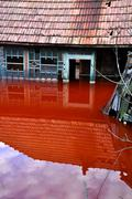 Village house flooded by polluted water from a copper mine Stock Photos