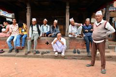 Nepali men resting at afternoon in Bhaktapur Stock Photos