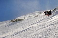 Hiking in wintertime. Retezat mountains, Carpathians, Romania Stock Photos