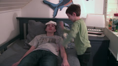 Fever, cold and flu, younger brother takes care of sick older brother - stock footage