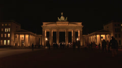104 Berlin, Brandenburger Tor by night with people - stock footage
