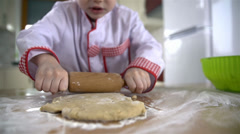 Close up of rolling dough with rolling pin - stock footage