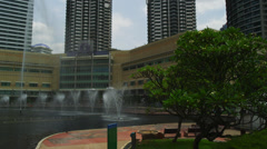 The Fountains and park at the rear of KLCC - stock footage