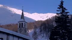 Italian ski resort church tower, lifts and mountain - stock footage