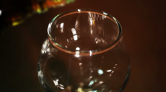 Gold cognac, brandy is poured  close up Stock Footage