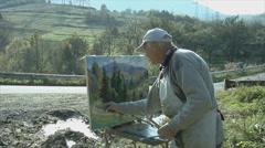 Artist painting landscape Stock Footage