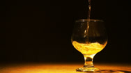 Stock Video Footage of Gold cognac, brandy is poured