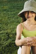 portrait of smiling nine year old girl, field of grass in background - stock photo