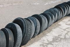 row of discarded tires - stock photo