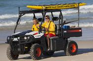 Stock Photo of two beach lifesavers in a surf patrol cart. fingal bay. port stephens. australia