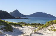 Stock Photo of landscape with sand dunes ocean islands and hills. fingal bay. port stephens.