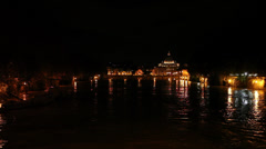 The Tiber river and St Peter's Basilica by night Stock Footage