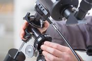 Stock Photo of adjusting telescope