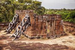 leaning building at east mebon temple - stock photo