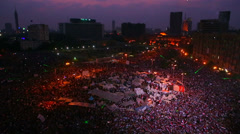 Fireworks go off above protestors gathered in Tahrir Square in Cairo, Egypt at a - stock footage