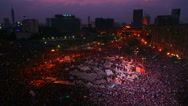 Stock Video Footage of Fireworks go off above protestors gathered in Tahrir Square in Cairo, Egypt at a