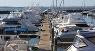 Stock Photo of yachts and motor boats at harbor moored at marina. port  stephens. nelson bay
