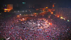 View overlooking an enormous nighttime rally in Tahrir Square in Cairo, Egypt. - stock footage