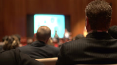 Stock Video Footage of Back of audience at business conference (1 of 2)