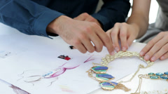 Design team looking at costume jewelry - stock footage