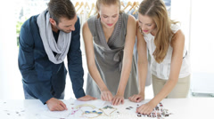 Fashion design team looking at costume jewelry - stock footage