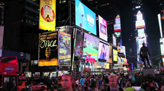 Times Square lit up and crowded at night. Stock Footage