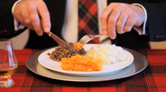 Man Eating Scottish Haggis Stock Footage
