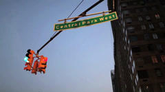 Tilt down from a sign reading Central Park West to a busy intersection in New Stock Footage