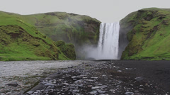 Skógafoss waterfall: front view / slow motion / Iceland - stock footage