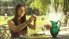 Beautiful girl text messaging, taking a selfie on her cell phone Stock Footage