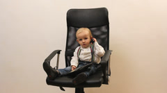 Little boy with fixed line telephone at office Stock Footage