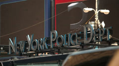 Traffic passes before a sign for the New York Police Department in New York Stock Footage