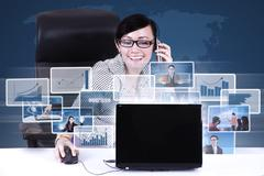 businesswoman calling and networking using laptop - stock illustration