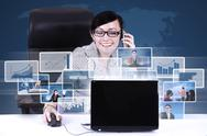 Stock Illustration of businesswoman calling and networking using laptop