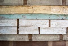 Stack of peel colorf wood on wall as texture Stock Photos