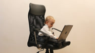 Stock Video Footage of Little businessman working hard at office