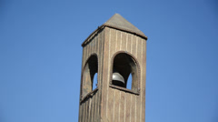 Belfry imitation with bell move on background of blue sky Stock Footage